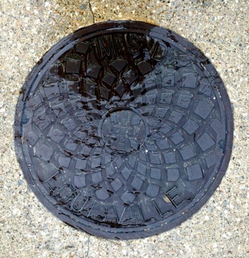 manhole under melt water crop 1