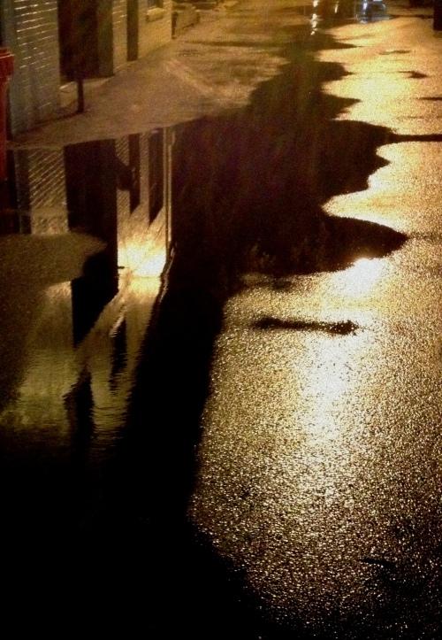 alley puddle facade