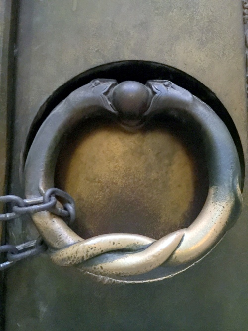 oroboric snake door ring nashville parthenon